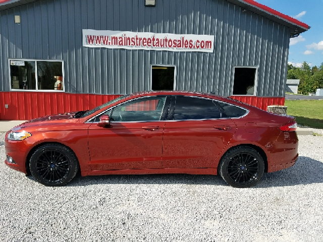 2014 Ford Fusion for sale at MAIN STREET AUTO SALES INC in Austin IN