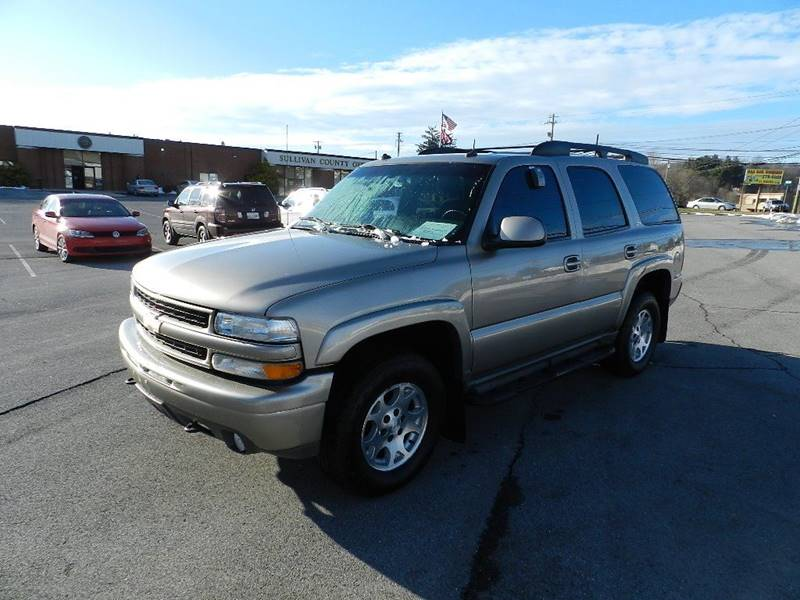2003 CHEVROLET TAHOE LT pewter the front windshield is in excellent condition  the paint is in g
