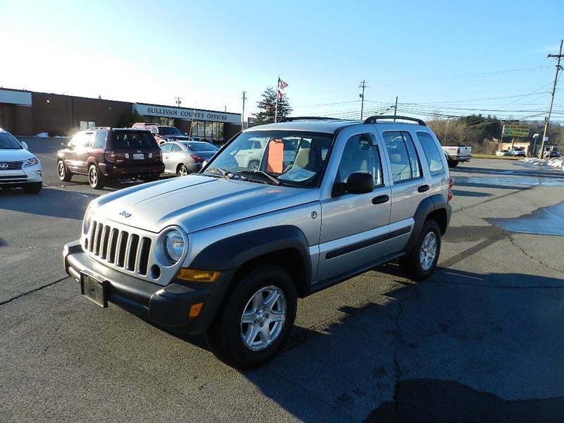 2006 JEEP LIBERTY SPORT silver the front windshield is in excellent condition  the paint is in g
