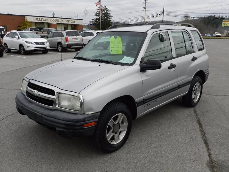 2003 CHEVROLET TRACKER BASE gray the front windshield is in excellent condition  the paint is in