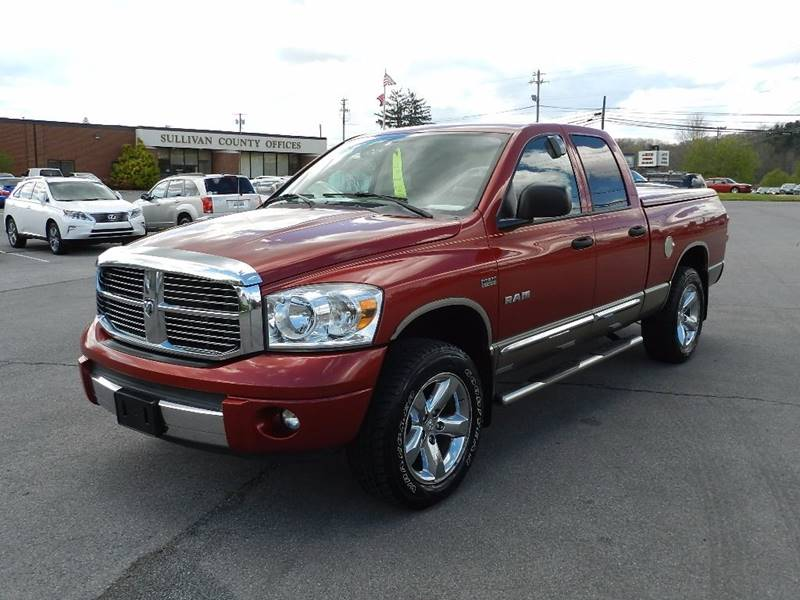2008 DODGE RAM PICKUP 1500 LARAMIE 4DR QUAD CAB 4WD SB red the front windshield is in excellent c