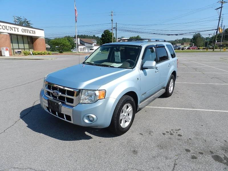 2008 FORD ESCAPE HYBRID BASE AWD 4DR SUV teal the front windshield is in excellent condition  th