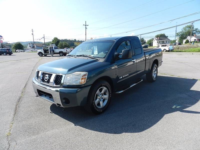 2006 NISSAN TITAN SE FFV 4DR KING CAB SB teal the front windshield is in excellent condition  th