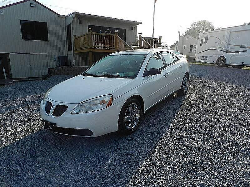2006 PONTIAC G6 GT 4DR SEDAN white the front windshield is in excellent condition  the paint has