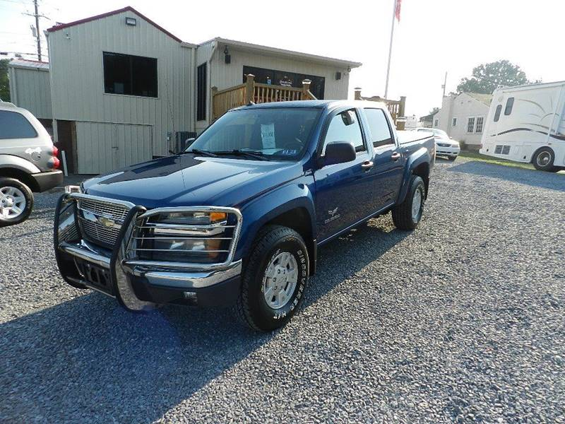 2005 CHEVROLET COLORADO Z71 LS BASE 4DR CREW CAB 4WD SB blue the front windshield is in excellent