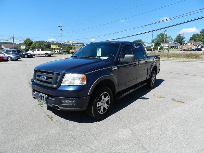 2004 FORD F-150 LARIAT 4DR SUPERCREW 4WD STYLESI blue front bumper color - chrome rear bumper co