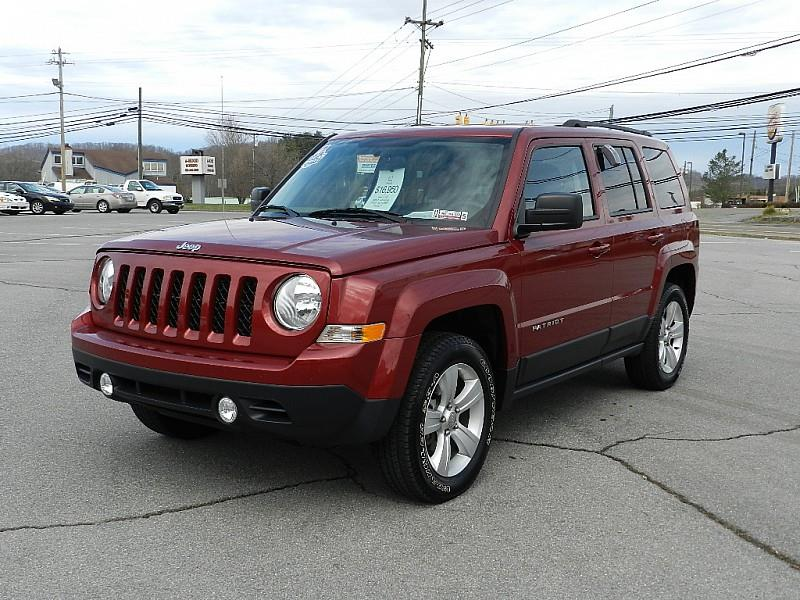 2015 JEEP PATRIOT SPORT 4X4 4DR SUV maroon the front windshield is in excellent condition  the p