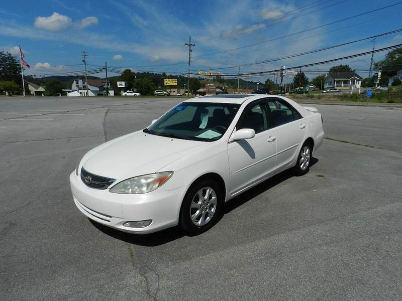 2004 TOYOTA CAMRY LE 4DR SEDAN white cassette center console clock cruise control daytime run