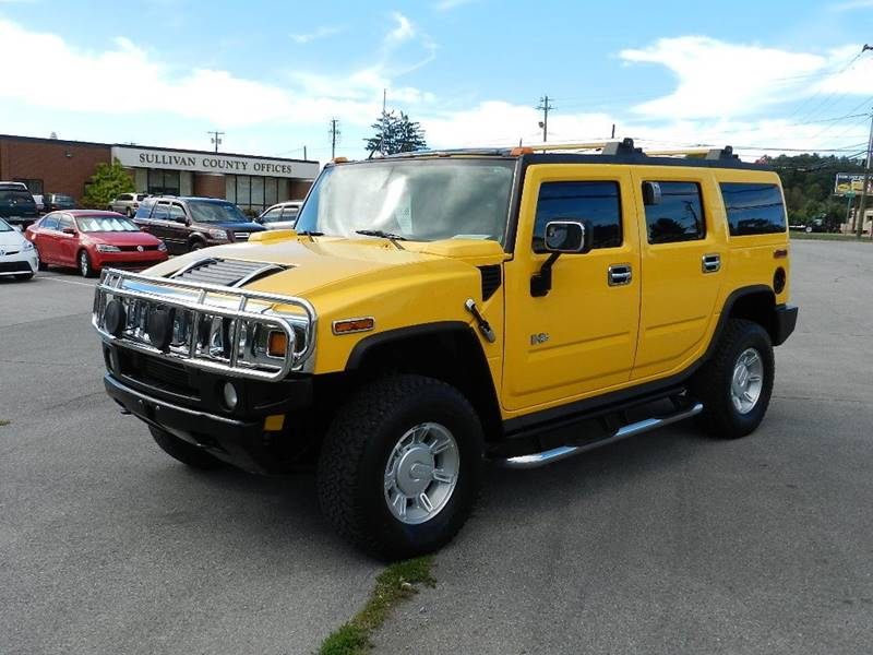 2003 HUMMER H2 LUX SERIES yellow the front windshield is in excellent condition  the paint has s