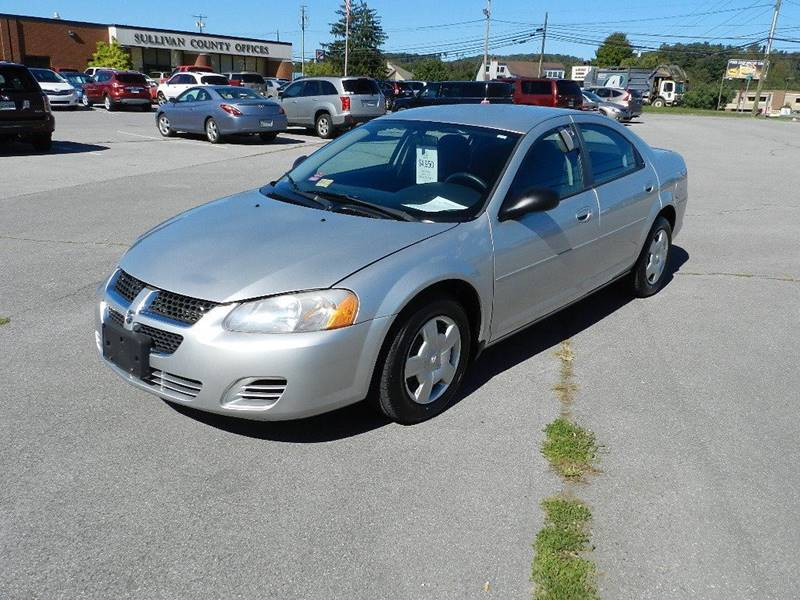 2005 DODGE STRATUS SXT silver the front windshield is in excellent condition  the paint has some