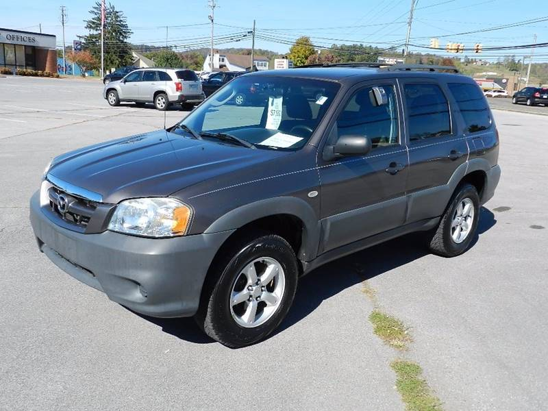 2006 MAZDA TRIBUTE I pewter the front windshield is in excellent condition  the paint is in grea