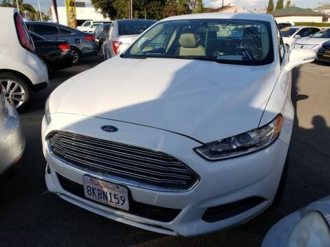 2014 Ford Fusion SE for sale at Car World Automotive in Hawthorne CA