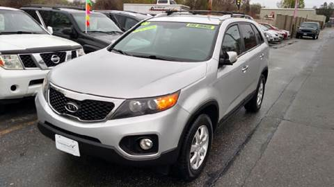 2011 Kia Sorento for sale at Howe's Auto Sales in Lowell MA