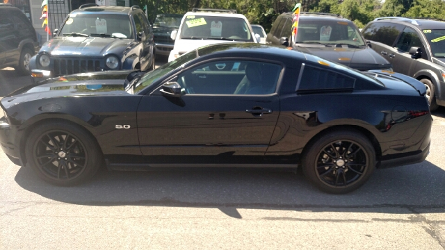 2012 Ford Mustang for sale at Howe's Auto Sales in Lowell MA