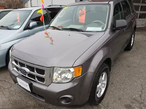 2009 Ford Escape for sale at Howe's Auto Sales in Lowell MA
