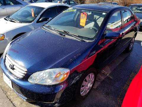 2003 Toyota Corolla for sale at Howe's Auto Sales in Lowell MA