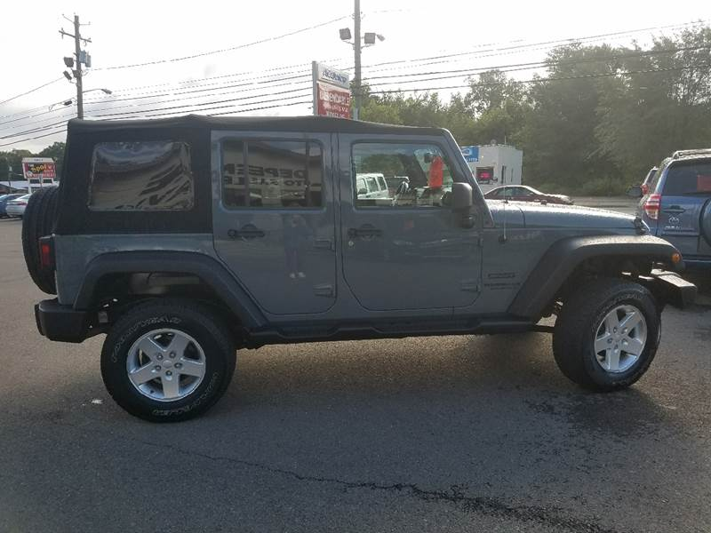2014 Jeep Wrangler Unlimited for sale at Dependable Auto Sales and Service in Binghamton NY