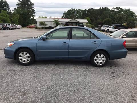 2004 Toyota Camry for sale at TAVERN MOTORS in Laurens SC