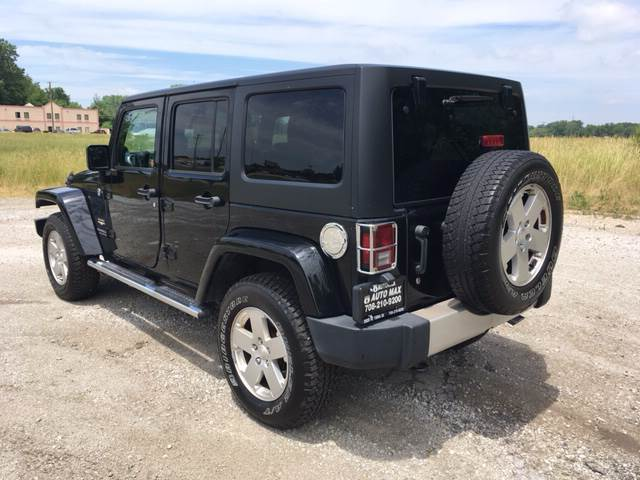 2012 Jeep Wrangler Unlimited for sale at ROUTE 6 AUTOMAX in Markham IL
