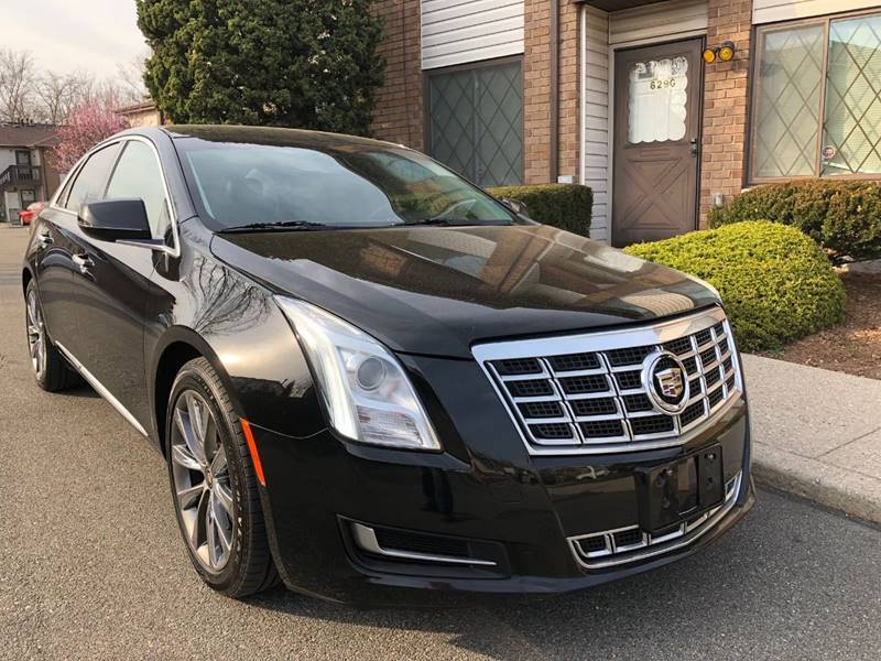 featured xts cadillac reviews autotrader large car new image review