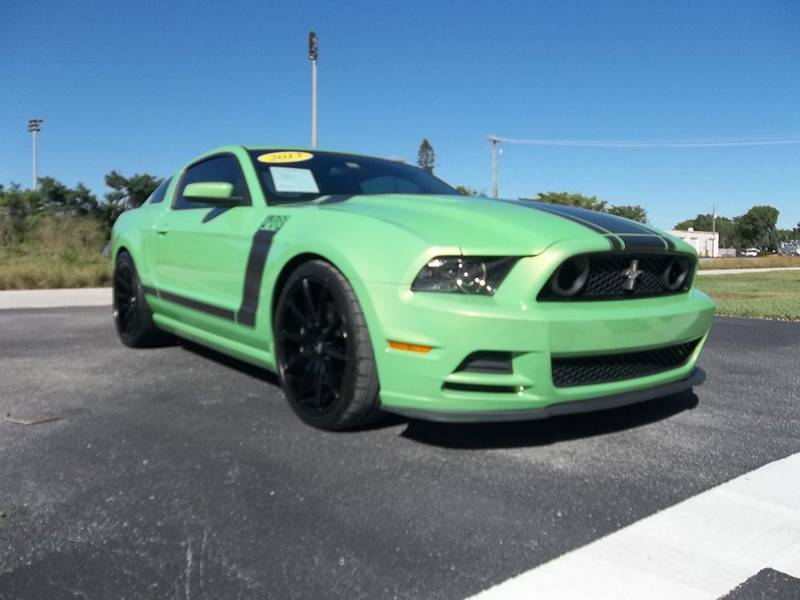 2013 Ford Mustang for sale at DELRAY AUTO MALL in Delray Beach FL