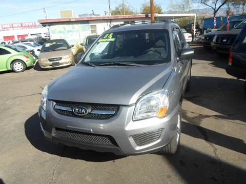 2009 Kia Sportage for sale at PARS AUTO SALES in Tucson AZ