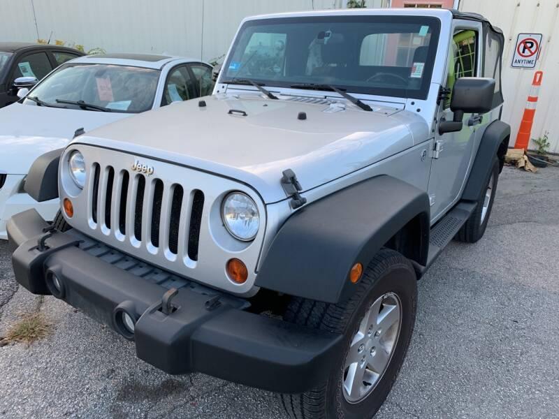 2011 Jeep Wrangler for sale at SODA MOTORS AUTO SALES LLC in Newport RI