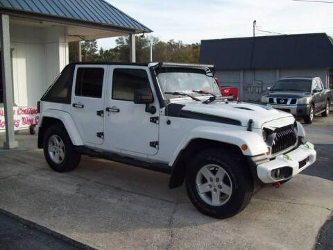 2010 Jeep Wrangler Unlimited Sport for sale at LONGSTREET AUTO in St Augustine FL