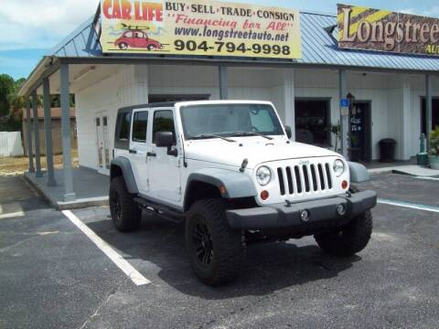 2011 Jeep Wrangler Unlimited for sale at LONGSTREET AUTO in St Augustine FL