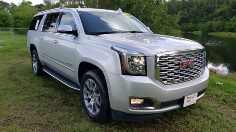 2019 GMC Yukon XL for sale at BOZARD FORD Lincoln in Saint Augustine FL