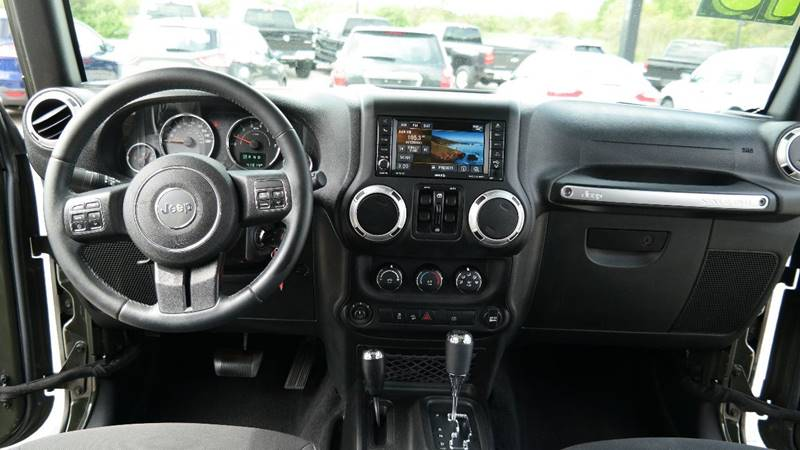 2015 Jeep Wrangler Unlimited for sale at Hekhuis Motorsports in Rockford MI