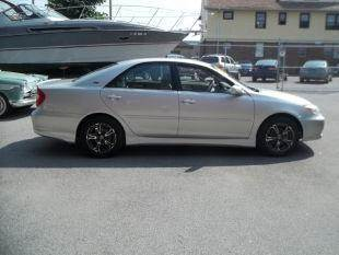 2004 Toyota Camry for sale at Champion Auto Sales II INC in Rochester NY