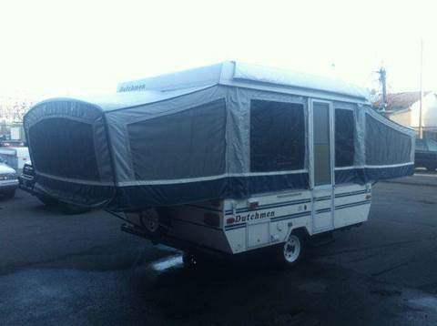 1996 Dutchmen M-1003 for sale at Champion Auto Sales II INC in Rochester NY