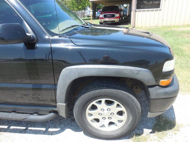 2003 Chevrolet Tahoe for sale at OTTO'S AUTO SALES in Gainesville TX