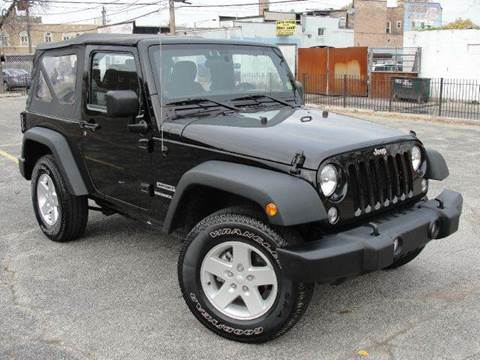 2014 Jeep Wrangler for sale at OUTBACK AUTO SALES INC in Chicago IL