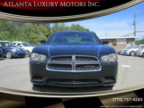 2014 Dodge Charger for sale at Atlanta Luxury Motors Inc. in Buford GA