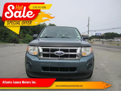 2011 Ford Escape for sale at Atlanta Luxury Motors Inc. in Buford GA