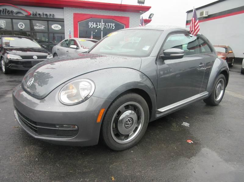 2012 VOLKSWAGEN BEETLE 25L PZEV 2DR HATCHBACK 6A charcoal this 2012 vw beetle with very low miles