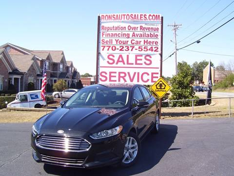 2014 Ford Fusion for sale at Rons Auto Sales INC in Lawrenceville GA