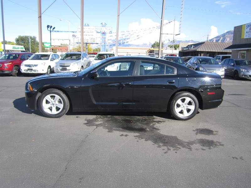 2014 Dodge Charger for sale at Smart Buy Auto Sales in Ogden UT