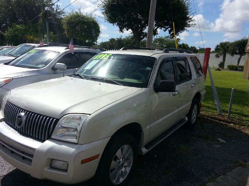 2006 MERCURY MOUNTAINEER CONVENIENCE AWD 4DR SUV off white please call schirras auto at 888-227-