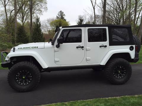 2015 Jeep Wrangler Unlimited for sale at Village Auto Sales in Milford CT
