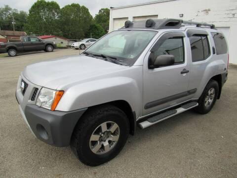 2013 Nissan Xterra for sale at Arnold Motor Company in Houston PA