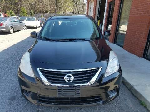2013 Nissan Versa for sale at Credit Cars LLC in Lawrenceville GA