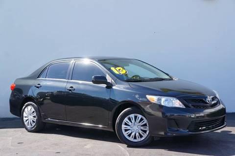 2013 Toyota Corolla for sale at Prado Auto Sales in Miami FL