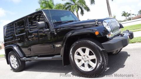 2012 Jeep Wrangler Unlimited for sale at MOTORCARS in West Palm Beach FL