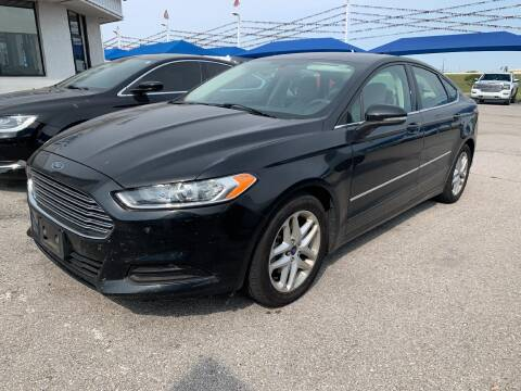 2014 Ford Fusion for sale at JOHN HOLT AUTO GROUP, INC. in Chickasha OK