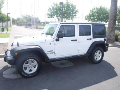 2013 Jeep Wrangler Unlimited for sale at J & E Auto Sales in Phoenix AZ
