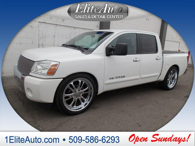 2006 NISSAN TITAN SE 4DR CREW CAB SB white we use carfax title history report to give you confide