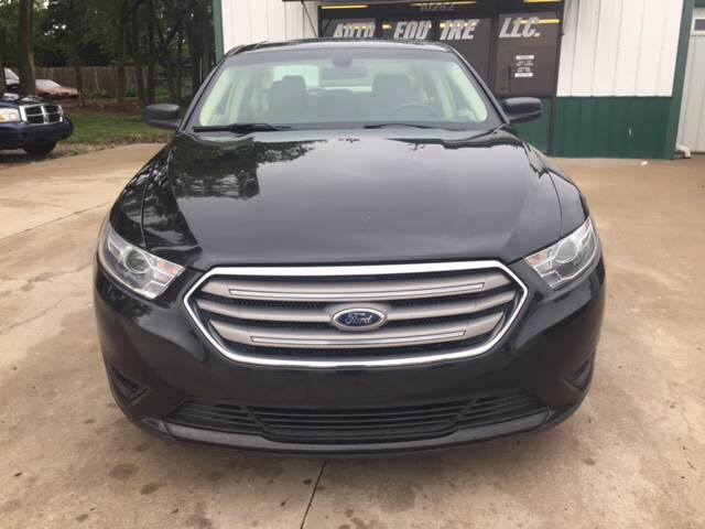 2013 Ford Taurus for sale at TOWN & COUNTRY MOTORS INC in Meriden KS